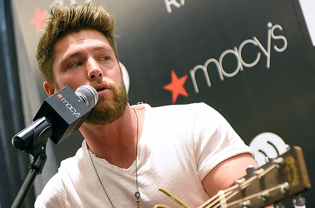 WINSTON SALEM, NC - MAY 16:  Macy's iHeartRadio Rising Star Chris Lane performs at Macy's Hanes on May 16, 2015 in Winston Salem, North Carolina.  (Photo by Grant Halverson/Getty Images for iHeart Media)